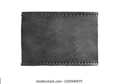Blank black leather label isolated over white