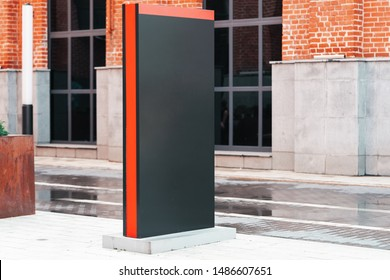 Blank black outdoor banner stand next to modern building. 3d rendering.