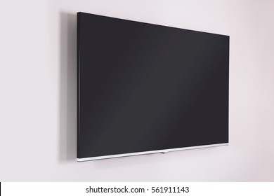 BLANK BLACK SCREEN HANGING ON WHITE WALL, MODERN INTERIOR DESIGN