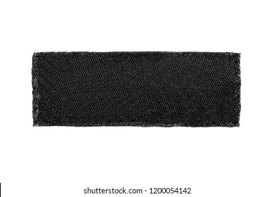 Blank black textile patch clothes label isolated over white