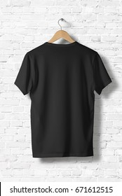 Blank Black T-Shirt Mock-up hanging on white wall, rear side view . Ready to replace your design