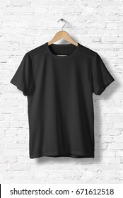 Blank Black T-Shirt Mock-up hanging on white wall, front side view . Ready to replace your design