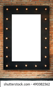 Blank black vintage poster frame with retro electric bulbs on the brick wall. Bar cafe caffe restaurant office shop warehouse sign. Retro style. Copy space. Vintage effect. Design wallpaper.