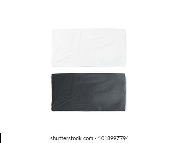 Blank black and white folded soft beach towel mockup. Clear wrapped wiper mock up laying on the floor. Shaggy fur bath textured jack-towel top view. Domestic cloth kitchen overlay template