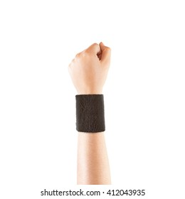 Blank black wristband mockup on hand, isolated. Clear sweat band mock up design. Sport sweatband template wear on wrist arm. Sports support protective bandage wrap. Bangle on the tennis player.
