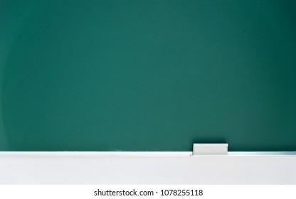 Blank blackboard with chalk eraser