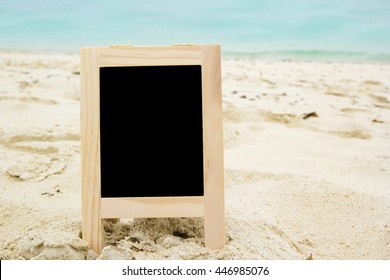 blank blackboard on the beach