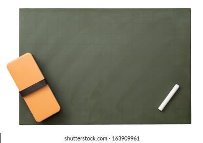 Blank blackboard with white chalks and eraser