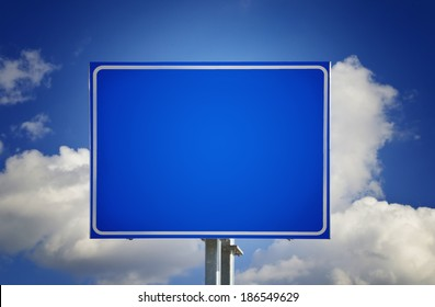 Blank Blue Road Sign with Sky and Clouds