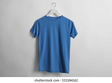 Blank blue t-shirt on light background