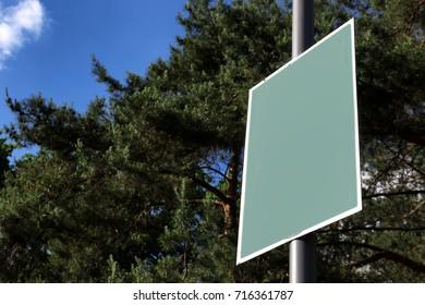 Blank board in green park on summer day