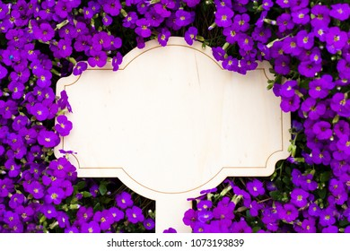 Blank board and lilac flowers, copyspace