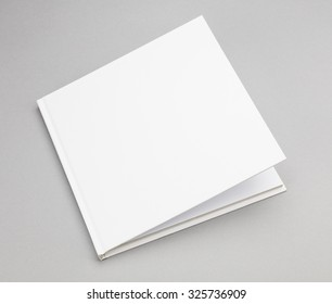 Blank book with ajar white cover