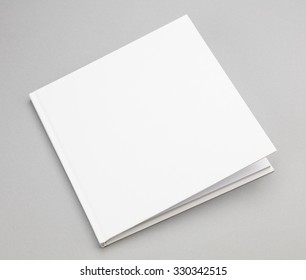 Blank book with ajar white cover 8,5 x 8,5 in