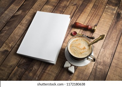 Blank book and coffee cup on vintage wood background. Responsive design template.