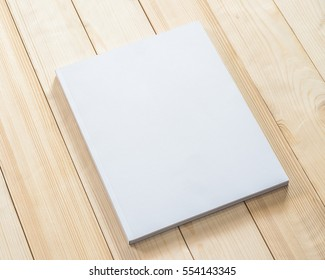 Blank book cover mockup template with page front side on white wood
