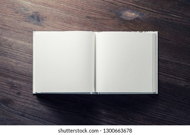 Blank book mock up on wooden background. Flat lay.