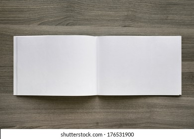 Blank. Booklet isolated on wooden textural background