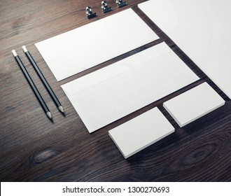 Blank branding mock-up. Blank envelopes, business cards and pencils on wooden background.