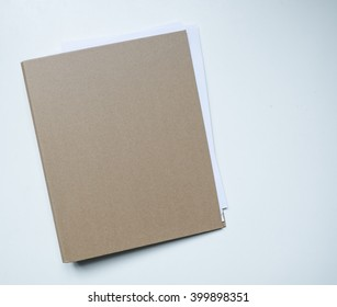 Blank brown card folder file with paper showing isolated on white background.