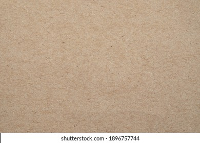 Blank, brown cardboard sheet paper, craft abstract background.  Retro, old vintage beige paper kraft pattern background. Design, minimal texture with empty, copy space for backdrop, can use recycle.