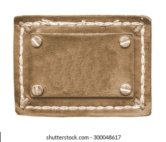 blank brown  jeans leather label decorated with buttons isolated on white