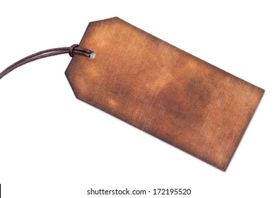 Blank brown leather tag isolated on white background