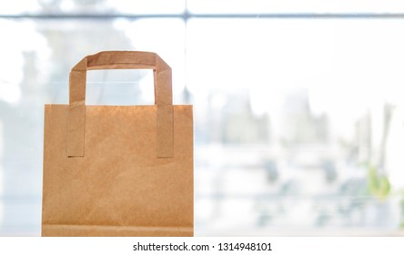 Blank brown paper bag on a light background