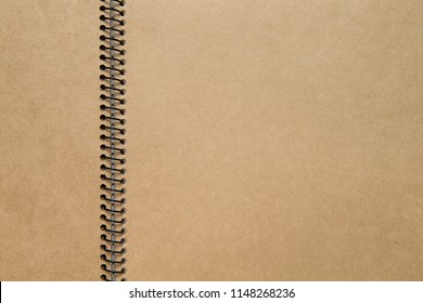 blank brown paper scrap book. close up shot. recycled paper notebook. unfolded ring book.