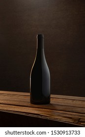 Blank Burgundy Wine Bottle Standing in Old Wood Plank