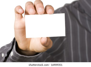 Blank business card held in hand by business person