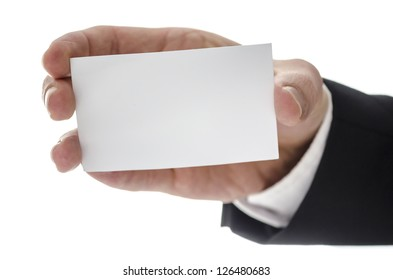 Blank business card in a male hand. Isolated over white background.