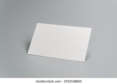 Blank business card on gray background