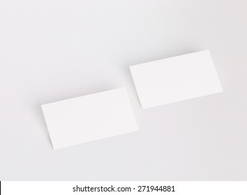 Blank business card on white background with soft shadows