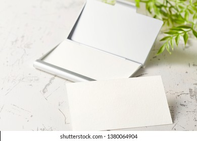 Blank business card on wooden table, business concept.