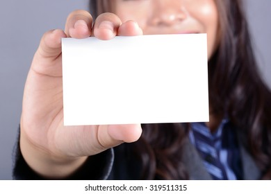 Blank business card shown by a businesswoman