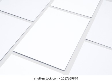 Blank business cards in checkerboard order isolated on white. 3d illustration of vertical cards to showcase your presentation.