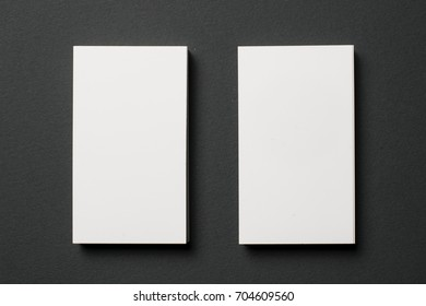 Blank business cards on dark textured background