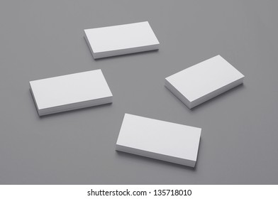Blank Business Cards on isolated on grey background with soft shadows