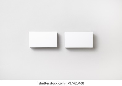 Blank business cards on paper background. Template for branding identity. Studio shot.