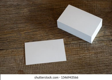 blank business cards on wooden surface