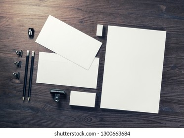 Blank business stationery set on wooden background. Corporate identity template. Branding mock-up. Flat lay.