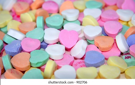 A blank candy heart surrounded by other candy hearts for your message.