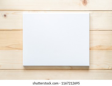 Blank canvas frame mockup square size on white wood wall for arts painting and photo hanging interior decoration