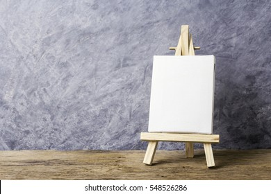 Blank canvas frame on easel painting