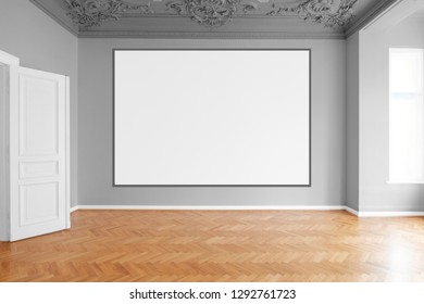 blank canvas or picture frame  hanging on white wall in empty room