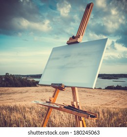 blank canvas rests on a easel on lake landscape, retro stylized