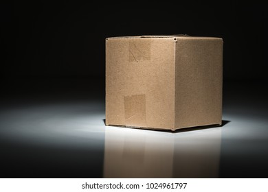 Blank Carboard Shipping Box Under Spot Light.
