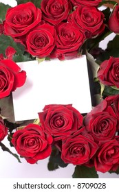 a blank card between red roses