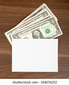 Blank card with cash on wooden table